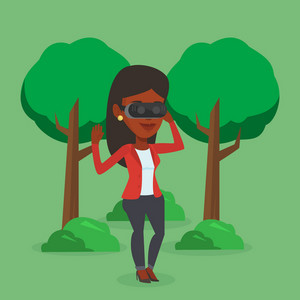 Young african-american gamer wearing virtual reality headset in the park. Happy woman using virtual reality glasses and playing videogame in the park. Vector flat design illustration. Square layout.