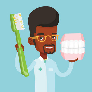 Young african-american male dentist holding dental jaw model and a toothbrush in hands. Friendly male dentist showing dental jaw model and toothbrush. Vector flat design illustration. Square layout.