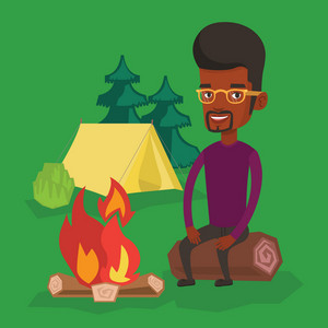 Young african-american man sitting near campfire at a campsite. Travelling man sitting on a log near a campfire. Smiling tourist relaxing near campfire. Vector flat design illustration. Square layout.