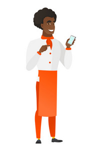 Young african chef cook holding mobile phone and pointing at it. Full length of chef cook with mobile phone. Chef cook using mobile phone. Vector flat design illustration isolated on white background.