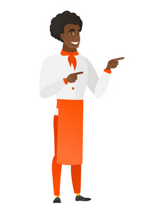 Young african chef cook in uniform pointing to the side. Chef cook pointing his finger to the side. Chef cook pointing to the right side. Vector flat design illustration isolated on white background.