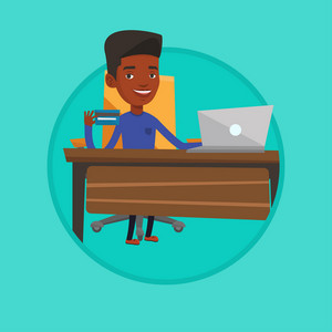 Young african man sitting at the table with laptop and holding credit card in hand. Man using laptop for online shopping at home. Vector flat design illustration in the circle isolated on background.