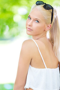 Young and beautiful blonde teenage girl outdoor