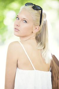 Young and beautiful teenage girl at summer