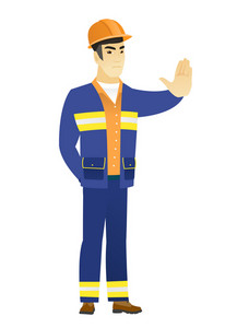 Young asian builder showing stop hand gesture. Full length of builder doing stop gesture. Serious builder with a stop gesture. Vector flat design illustration isolated on white background.