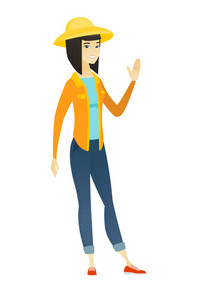 Young asian farmer waving her hand. Full length of cheerful farmer waving her hand. Happy farmer making greeting gesture - waving hand. Vector flat design illustration isolated on white background.