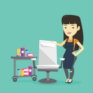 Young asian hair stylist standing near armchair and table with cosmetics in barber shop. Professional hair stylist standing at workplace in barber shop. Vector flat design illustration. Square layout.