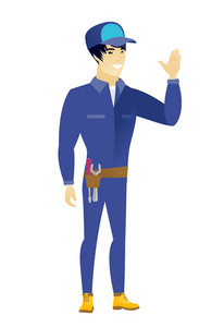 Young asian mechanic waving his hand. Full length of mechanic waving his hand. Mechanic making greeting gesture - waving hand. Vector flat design illustration isolated on white background