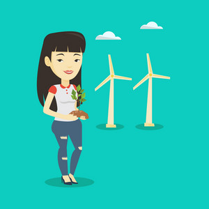 Young asian smiling worker of wind farm. Woman holding in hands green small plant in soil on the background of wind turbines. Concept of green energy. Vector flat design illustration. Square layout.