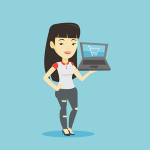 Young asian woman using laptop for online shopping. Female customer holding laptop with shopping trolley on a screen. Woman doing online shopping. Vector flat design illustration. Square layout.
