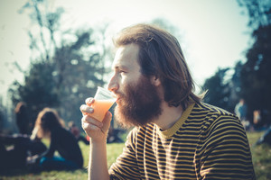 young bearded stylish handsome hipster man outdoors