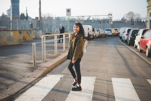 young beautiful asian hipster woman in the city - walking the street crosswalk having fun