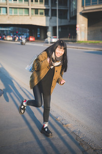 young beautiful asian hipster woman in the city