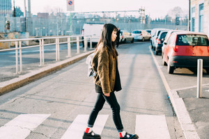 Young beautiful asian young woman walking crosswalk outdoor in the city back light - strolling, walking, student concept
