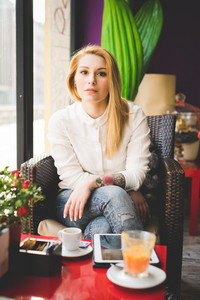 young beautiful blonde straight hair woman in the city sitting at the restaurant