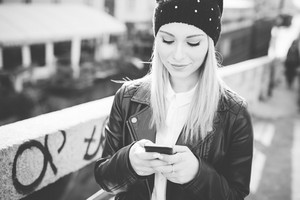 young beautiful blonde straight hair woman in the city using smartphone connected online on internet - social network, technology, connectivity concepts