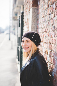 young beautiful blonde straight hair woman in the city
