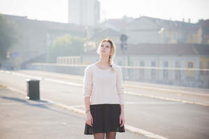 young beautiful blonde woman outdoor in the street of the city