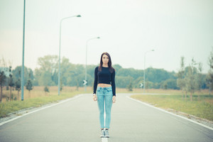 young beautiful brunette straight hair woman on the road outdoor