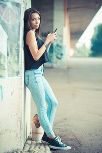 young beautiful brunette straight hair woman using smartphone outdoor