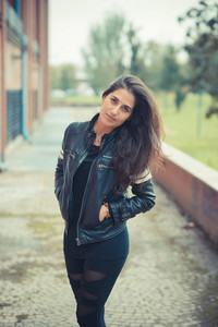 young beautiful brunette woman in the city