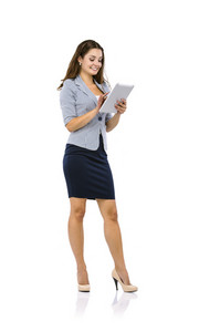 Young beautiful business woman with digital tablet on white isolated background.