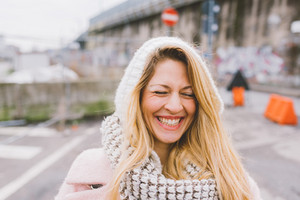 Young beautiful caucasian blonde hair woman outdoor in the city, smiling - happiness, confident, having fun concept