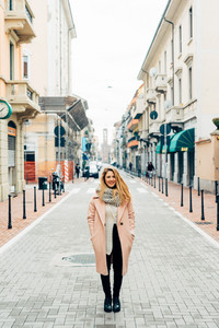 Young beautiful caucasian blonde hair woman posing outdoor in the city, smiling - happiness, confident, having fun concept