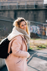 young beautiful caucasian blonde hair woman walking outdoor in the city, laughing - happiness, confident, having fun concept