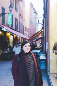Young beautiful caucasian curvy woman outdoor in the city looking in camera smiling serene - customer, happiness concept