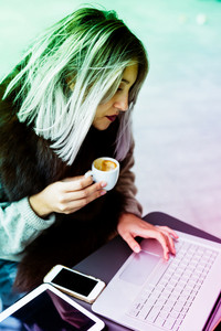 Young beautiful caucasian purple grey hair woman having a cup of coffee using notebook - business, creativity, break concept