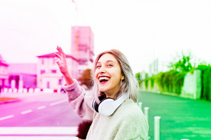 Young beautiful caucasian purple grey hair woman outdoor in the city, overlooking smiling - happiness, smiling, having fun concept
