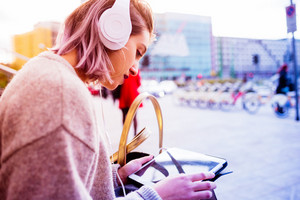 Young beautiful caucasian purple grey hair woman outdoor in the city using tablet and listening music with head phones - music, technology, social network concept
