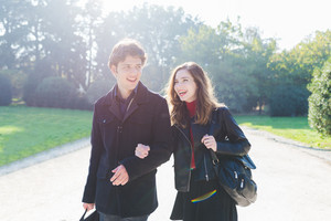 Young beautiful couple in love chatting outdoor in the city, back light, having fun - first date,  romantic, love concept