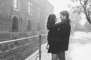 Young beautiful couple in love hugging outdoor in the city looking the eye - love, romantic, relationship concept. Black and white