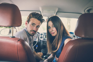 young beautiful couple lovers in the car