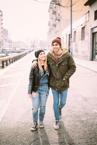 young beautiful couple lovers walking in the city