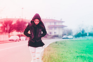 young beautiful eastern woman walking outdoor in the city wearing hoodie - walking, strolling, autumn concept