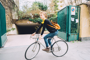Young beautiful hipster sporty blonde woman riding a bike outdoor in the city - sportive, transport concept