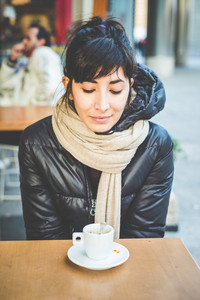 young beautiful hipster woman at the coffee bar in the city