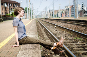 young beautiful hipster woman at the station