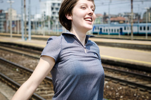young beautiful hipster woman happy running in the station