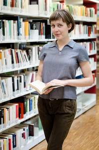 young beautiful hipster woman in library