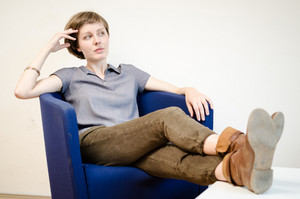 young beautiful hipster woman sitting in the armchair relaxing at home