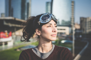 young beautiful hipster woman success aviator glasses  in the city