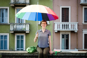 young beautiful hipster woman with colorful umbrella in the city