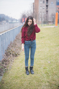 young beautiful long hair model woman living the city in winter outdoor city