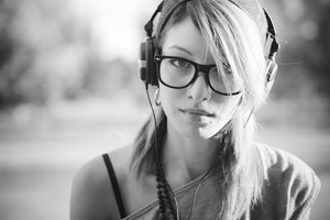 young beautiful model woman listening music in the city