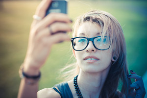 young beautiful model woman selfie in the city