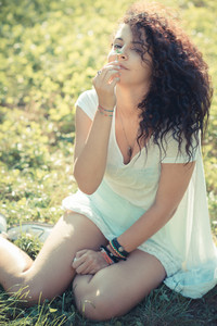 young beautiful moroccan curly woman at the park